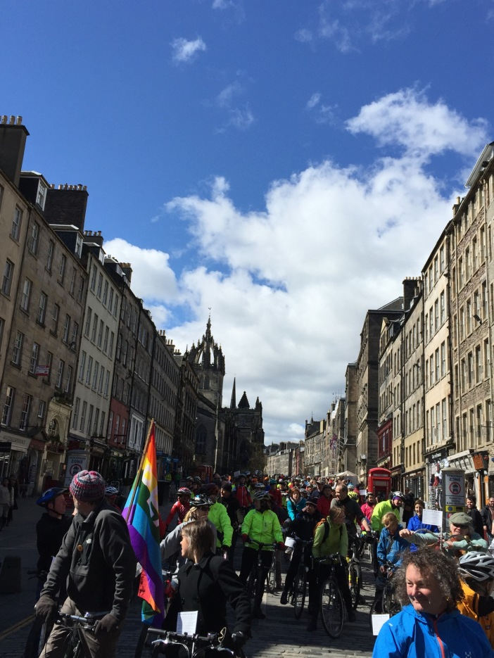 Cyclists coming down the Royal Mile, Edinburgh.